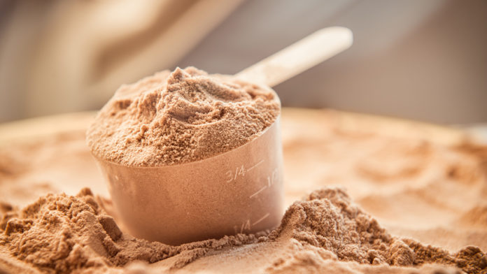Whey protein scoop.